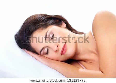 Young sleeping woman. Isolated on white background. - stock photo