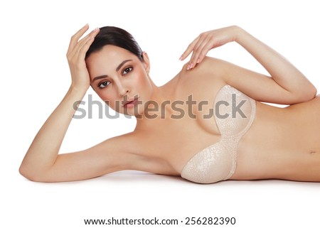 Young slim beautiful sexy woman in bra over white background - stock photo