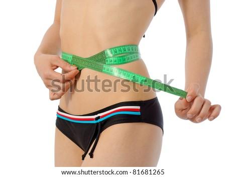 young slim girl measuring her waist - stock photo