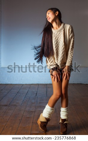 Young slim japanese woman fashion indoors portrait.
