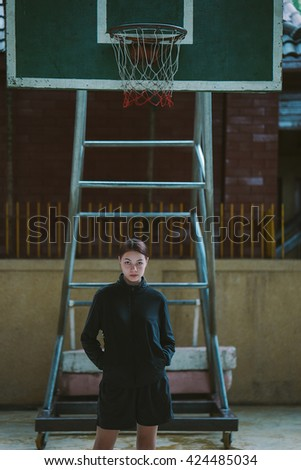 Young slim woman basketball player player. - stock photo