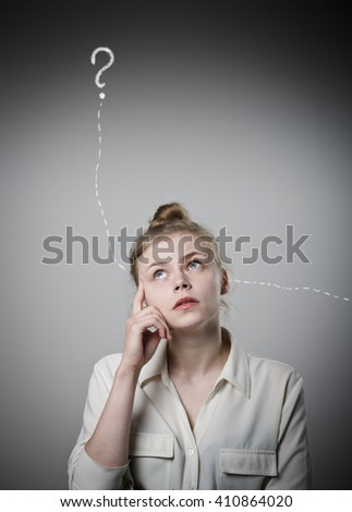 Young slim woman in white is full of doubts and hesitation. Girl and question mark above her head.