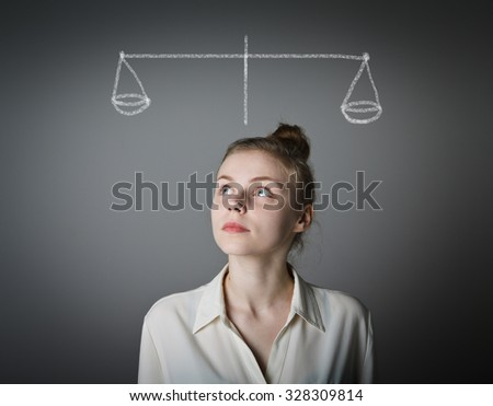 Young slim woman is full of doubts and hesitation. Scale. - stock photo
