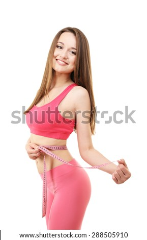 Young slim woman measuring her waist isolated on white - stock photo
