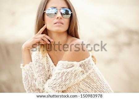 Young slim woman on beach portrait.  - stock photo