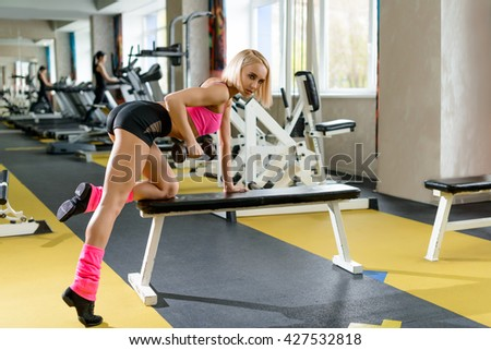 Young slim woman training in a gym