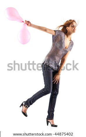 Young slim woman with balloons. Isolated on white. - stock photo