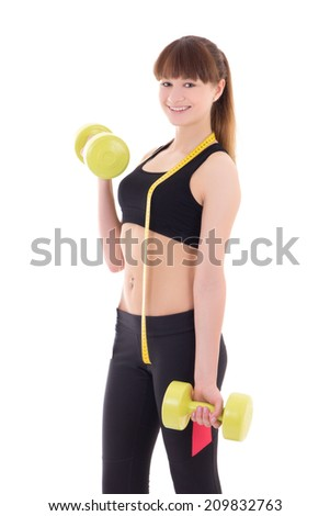 young slim woman with dumbbells and measure tape isolated on white background