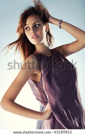 Young slim woman with fluttering hair portrait. - stock photo