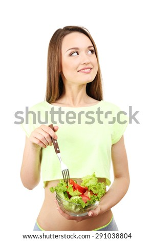 Young slim woman with glass bowl of diet salad isolated on white