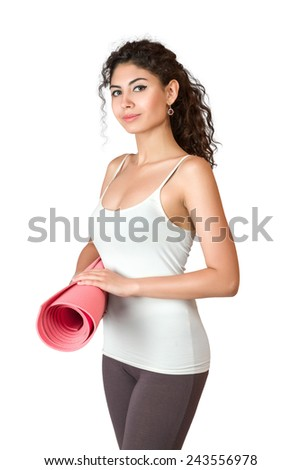 Young slim woman with gymnastics mat isolated over white background - stock photo