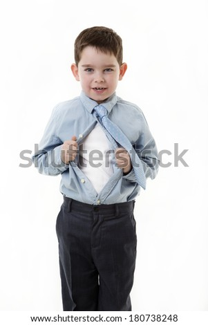young small boy dress as an office worker pulling his shirt apart doing a superhero poses