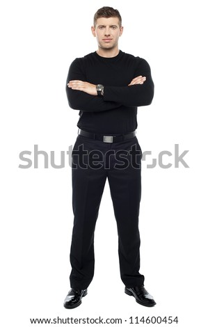 Young smart bouncer posing with his arms crossed isolated over white background. - stock photo