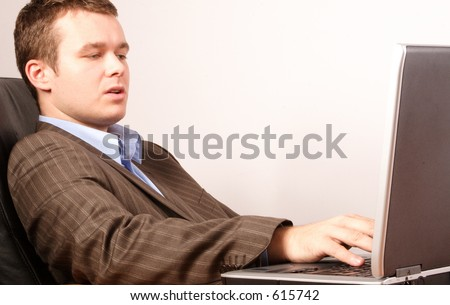 young smart casual business man working on laptop