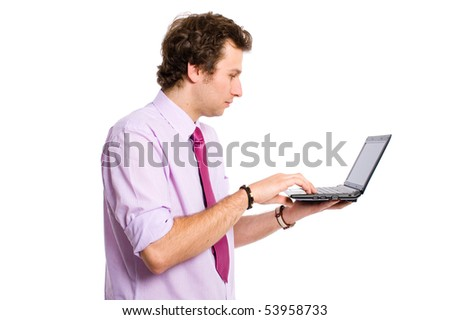 young smart looking and confident adult working on small laptop computer or netbook, all isolated on white background