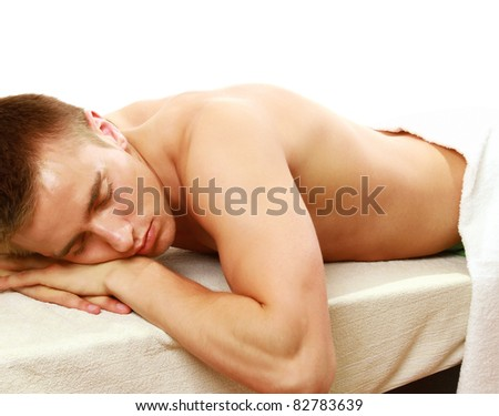 Young smart male enjoying massage