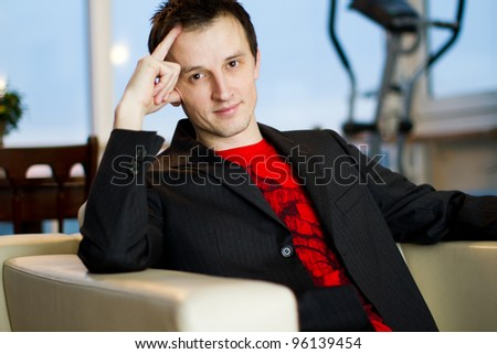 young smart professional man sat at home - stock photo
