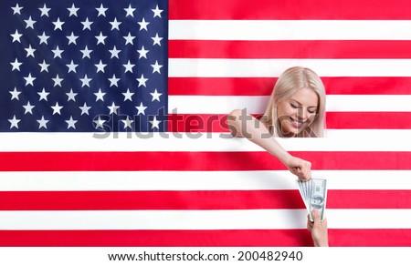 Young smiiling girl takes money - stock photo