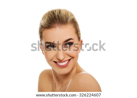 Young smile naked woman, isolated on white.