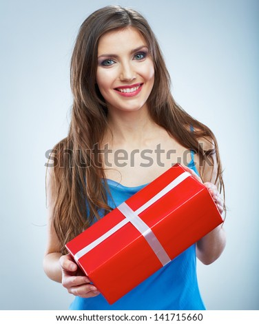 Young smile woman hold red gift box with white ribbon. Isolated studio background female model. - stock photo