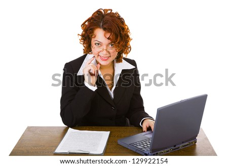 young smiley attractive businesswoman sitting at table with laptop - stock photo