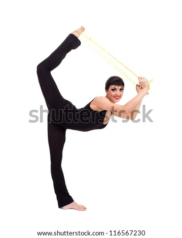 Young smiling acrobat posing against isolated white background