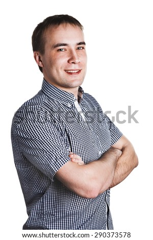 Young smiling attractive man stands and looks at you. Brunette with a short hairstyle. Portrait isolated on white background.