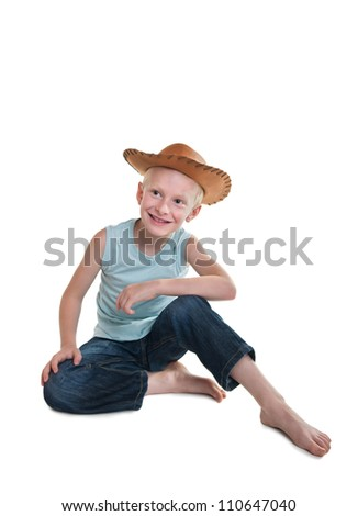 young smiling boy wearing cowboy hat - stock photo