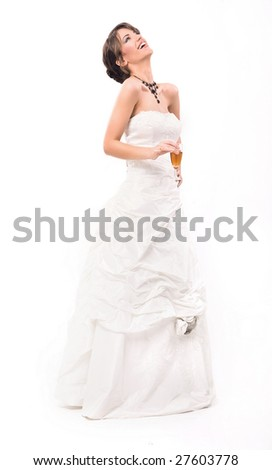 Young smiling bride with glass of champagne
