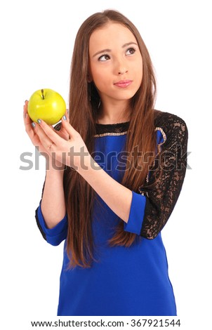 Young smiling brunette girl holding green apple isolated on white - stock photo