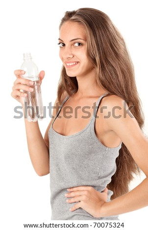 Young smiling brunette lady with bottle of mineral water on white