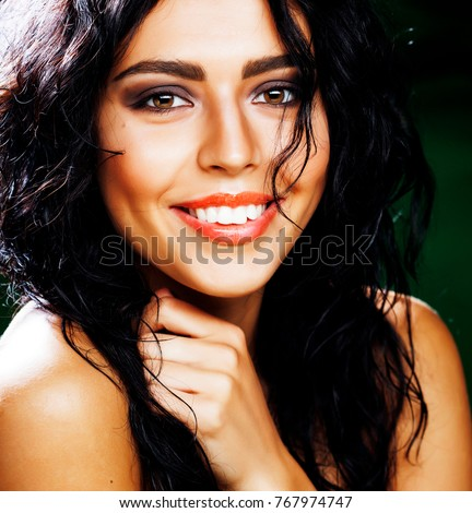 young smiling brunette woman on green background