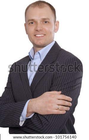Young smiling business man with his colleagues in a meeting at office - stock photo