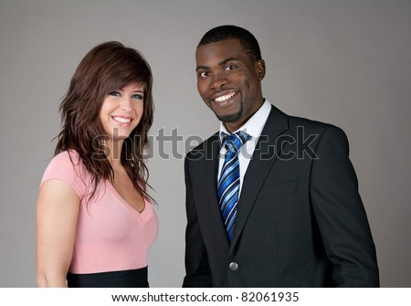 Young smiling business partners, Caucasian woman and African American man. - stock photo