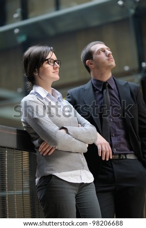 Young smiling business woman and business man portrait - stock photo