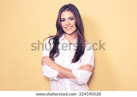 young smiling business woman portrait . white shirt. yellow background. - stock photo
