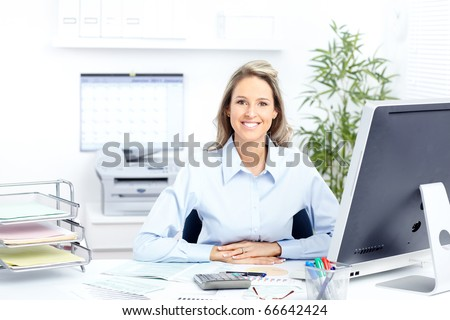 Young smiling  business woman working with computer