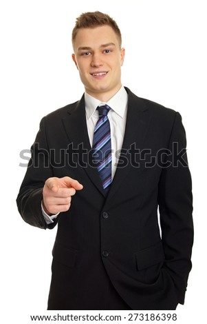 Young smiling businessman in suit shows on you
