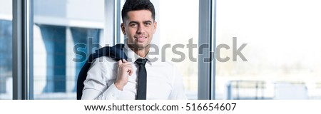 Young smiling businessman on his way to the office