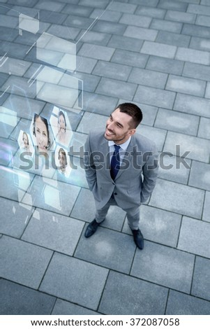 young smiling businessman outdoors from top - stock photo