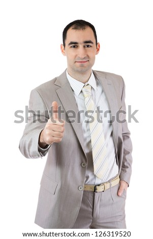 Young smiling businessman showing thumbs up./Success