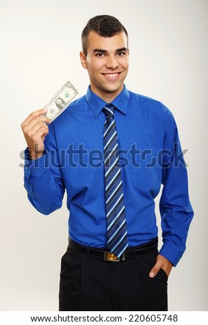 Young smiling businessman shows you one dollar - stock photo