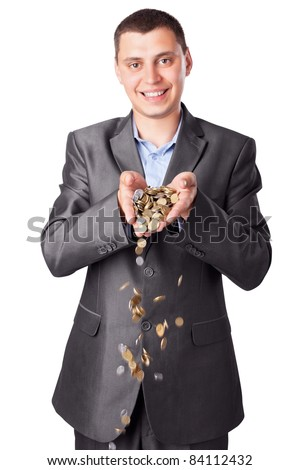young smiling businessman with heap of coins isolated on white background - stock photo
