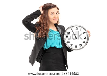 Young smiling businesswoman holding a wall clock isolated on white background