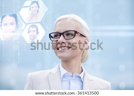 young smiling businesswoman in eyeglasses outdoors - stock photo
