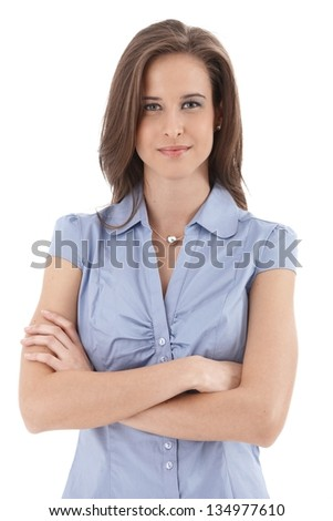 Young smiling businesswoman portrait, standing with arms folded, isolated on white. - stock photo