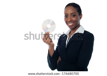 Young smiling businesswoman showing CD