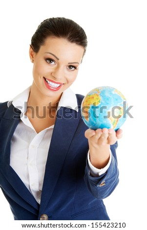 Young smiling businesswomen with globe