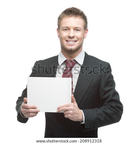 young smiling caucasian businessman in black suit holding sign isolated on white - stock photo