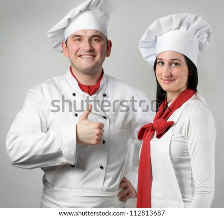 Young smiling chef man and  woman.